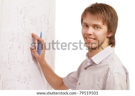 A young man near a diagram, isolated on white, side-view - stock photo