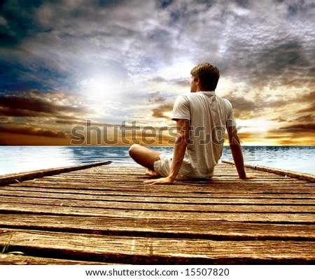 a young man on a wharf - stock photo