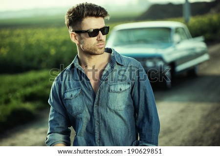 A young man on the background of car - stock photo