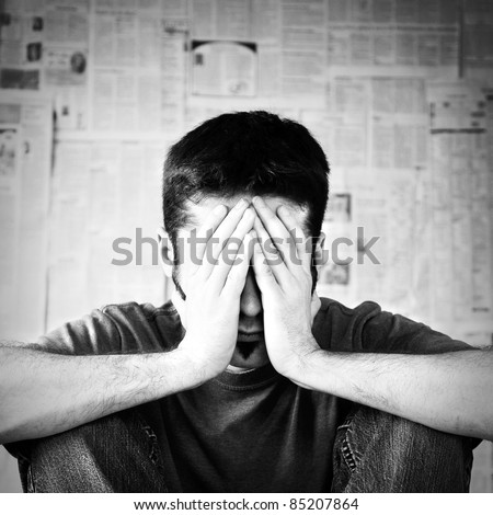 A young man overwhelmed with bad news. - stock photo