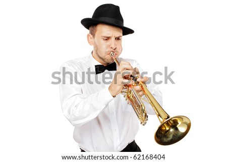 A young man playing a trumpet isolated on white background - stock photo