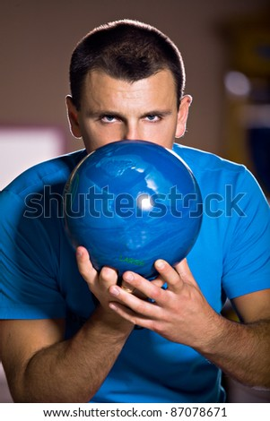 a young man playing bowling - stock photo