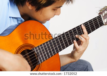 A young man playing guitar