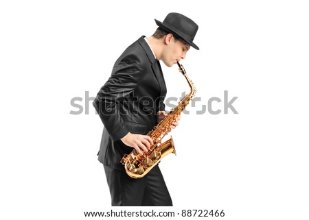 A young man playing on saxophone isolated on white background