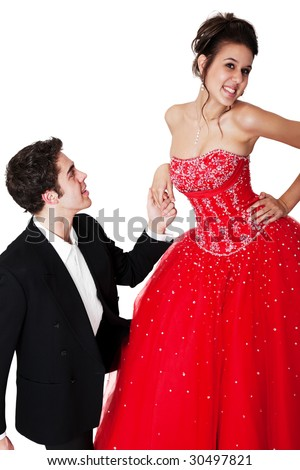 A young man pledging his love to a girl who is not taking it seriously. - stock photo