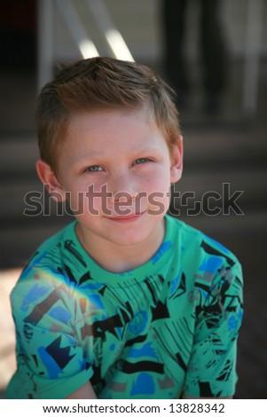 a young man poses for photos - stock photo