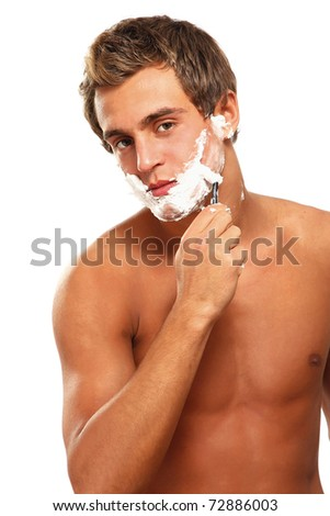 a young man shaving - stock photo
