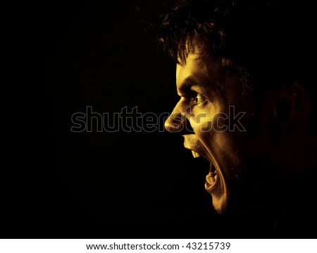 a young man shouting - stock photo