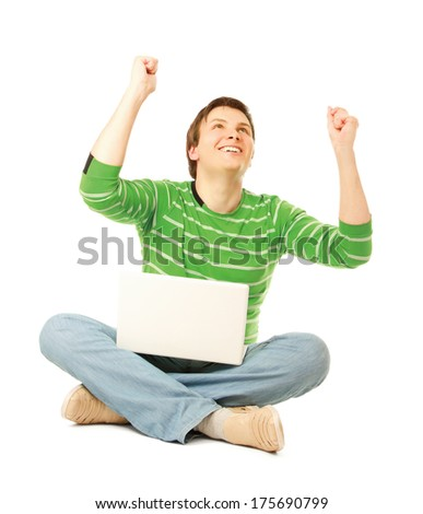 A young man sitting on the floor with a laptop, isolated on white - stock photo