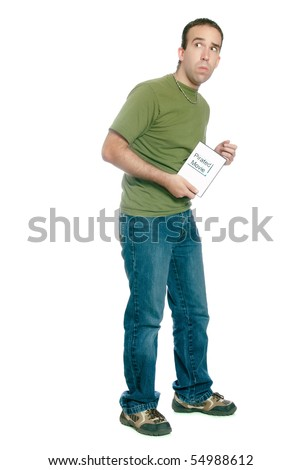 A young man sneaking away with an illegal movie download, isolated against a white background. - stock photo