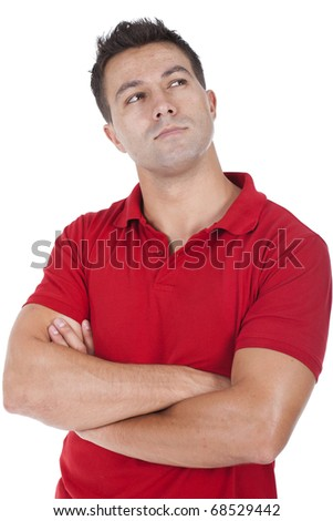 a young man standing and thinking - stock photo