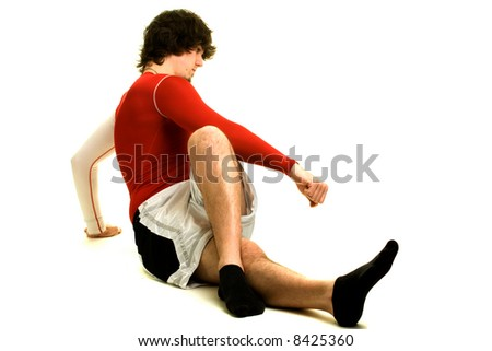 A young man stretching over a white background. - stock photo