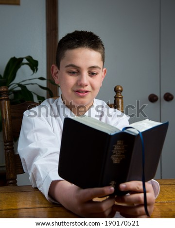 A young man studying the scriptures. - stock photo