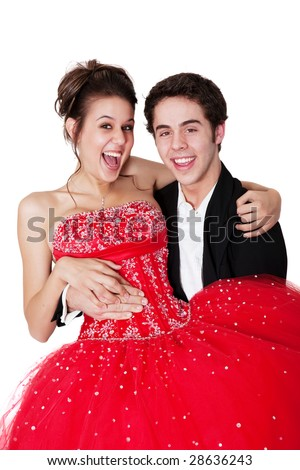 A young man sweeps his prom date off her feet. - stock photo