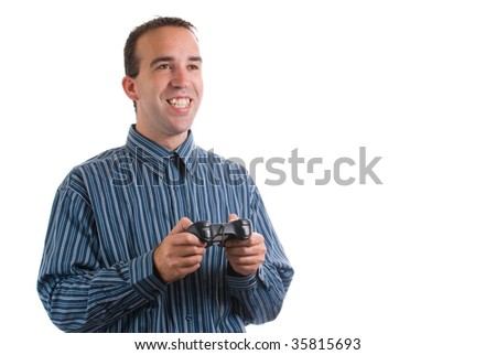 A young man using a remote control to play video games, isolated against a white background - stock photo