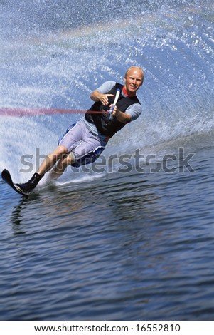 A young man water skiing - stock photo