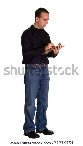 A young man wearing casual clothing, taking inventory with a clipboard - stock photo