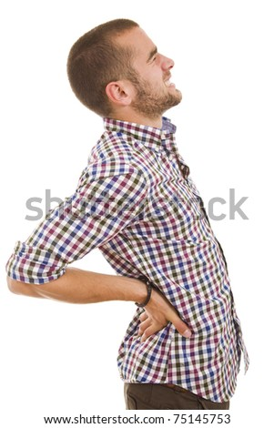 A young man with a backache - stock photo