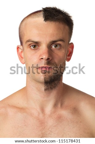 A young man with a beard on half of the face - stock photo