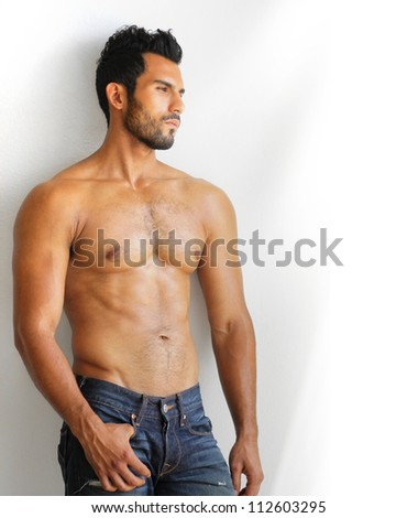 A young man with a beautiful physique - stock photo