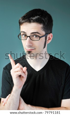 A young man with a bright idea. - stock photo