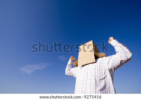 a young man with a cardboard hiding his head - stock photo