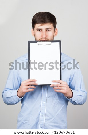 A young man with a clipboard
