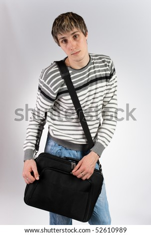 a young man with a computer bag - stock photo