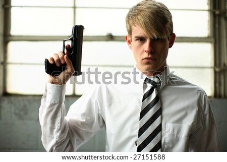 A young man with a gun.