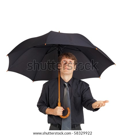 A young man with a large black umbrella on white