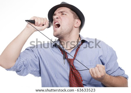 a young man with a microphone and singing - stock photo
