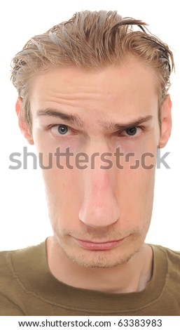 A young man with a really long distorted face isolated on white background - stock photo