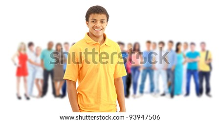 a young man with big group of the young smiling students. Over white background - stock photo