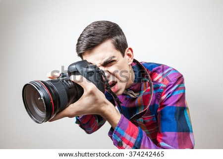 A young man with camera - stock photo