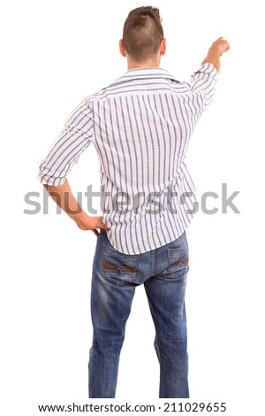 A young man with his back turned to camera, pointing to something - stock photo