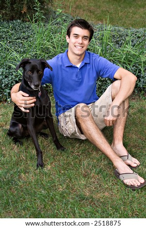 A young man with his dog. - stock photo