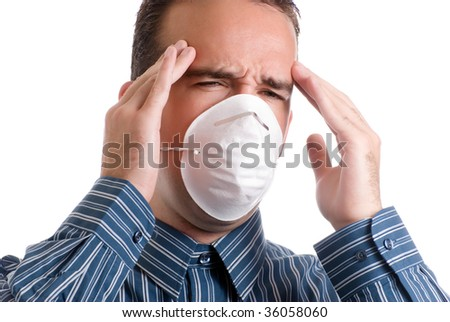 A young man with influenza is suffering from a major headache, isolated against a white background - stock photo
