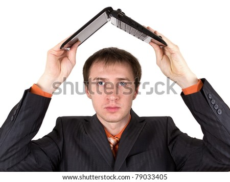 A young man with laptop - stock photo