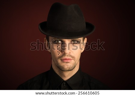 a young man  with  make  up and painted tears.  - stock photo