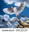 A young man with wings on a background of blue sky - stock photo