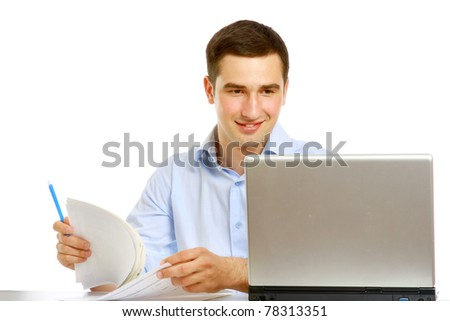 A young man working - stock photo