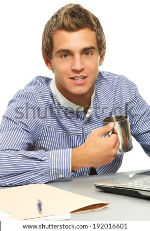 A young man working with papers - stock photo