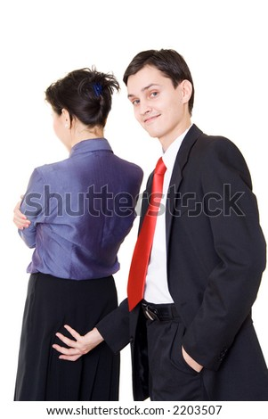 A young manager sexually soliciting his female colleague - stock photo