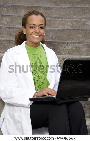 A young medical doctor using a computer