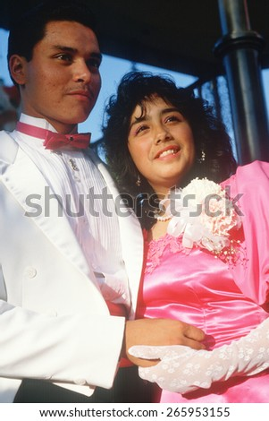A young Mexican couple in formal attire, Olvera Street, Los Angeles, CA - stock photo
