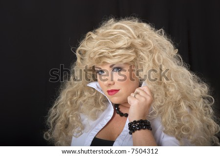 A young model in blonde wig posing for the camera