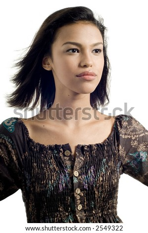 A young model stares away from camera on white background