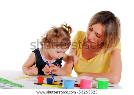a young mom and her little daughter paint colors in this album