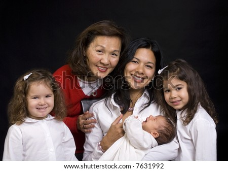 A young mother and daughters and parent with a newborn girl. Family, love, caring. - stock photo