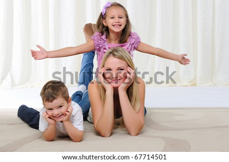 A young mother, her daughter and son having fun together